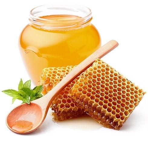 honey jar with honey spoon